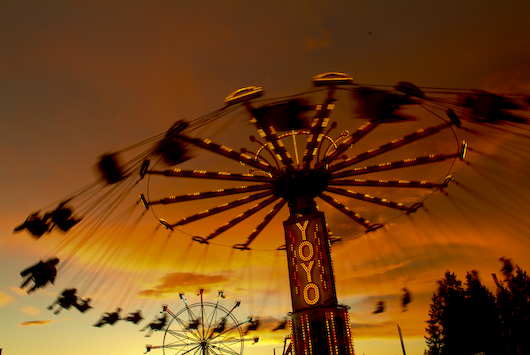 Carnival Ride and Setting Sun